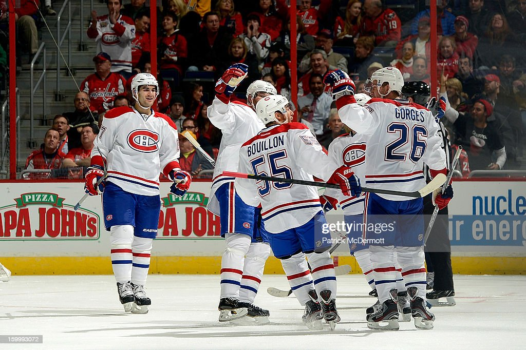 Josh Gorges of the Montreal Canadiens is congratulated by teammates after his second period goal during an NHL hockey game against the Washington...