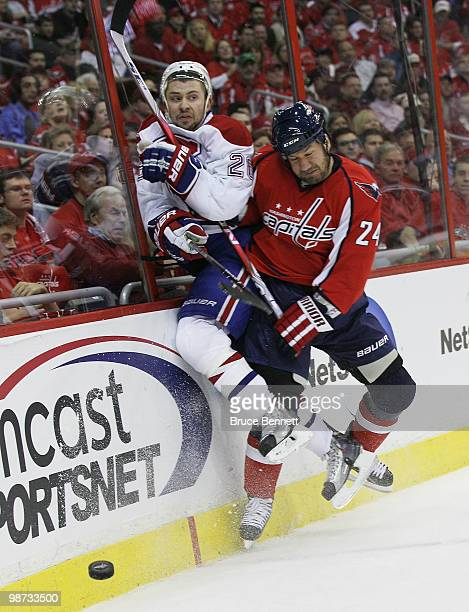 Josh Gorges of the Montreal Canadiens is hit into the boards by Scott Walker of the Washington Capitals in Game Seven of the Eastern Conference...