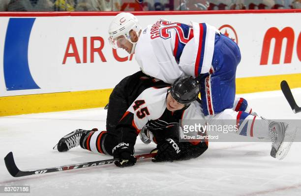 Josh Gorges of the Montreal Canadiens pins Arron Asham of the Philadelphia Flyers to the ice during their NHL game at the Bell Centre November 15...