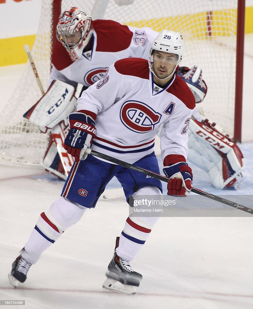 <a gi-track='captionPersonalityLinkClicked' href=/galleries/search?phrase=Josh+Gorges&family=editorial&specificpeople=550446 ng-click='$event.stopPropagation()'>Josh Gorges</a> #26 of the Montreal Canadiens skates on the ice in his 500th career game in the NHL in first period action against the Winnipeg Jets at the MTS Centre on October 15, 2013 in Winnipeg, Manitoba, Canada.