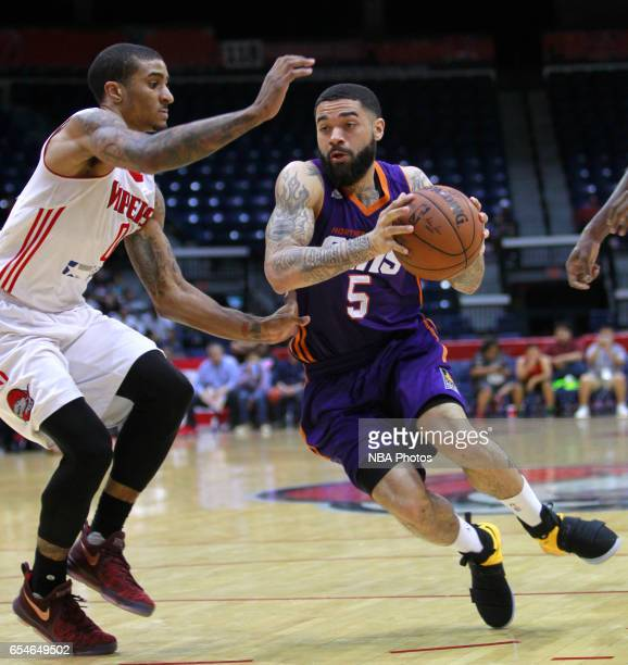 Josh Gray of the Northern Arizona Suns drives to the net on Gary Payton II of the Rio Grande Valley Vipers at the State Farm Arena March 17 2017 in...