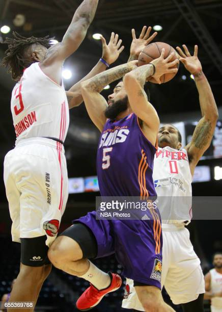 Josh Gray of the Northern Arizona Suns looks for a pass between Jaron Johnson left and Gary Payton II of the Rio Grande Valley Vipers at the State...
