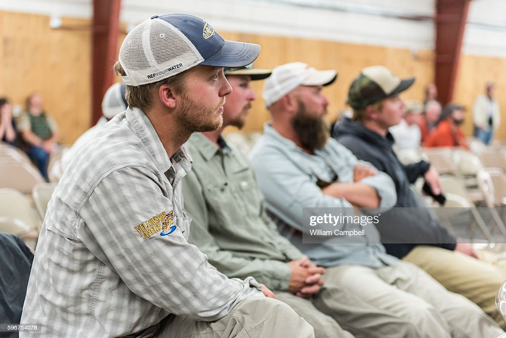 Josh Green from the Yellowstone Angler fly fishing shop sits with fly fishing guides at community meeting in Livingston MT on August 24 2016 attended...