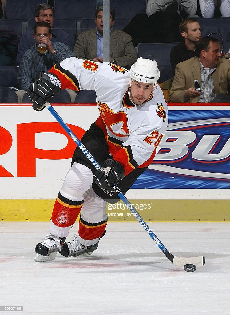 Josh Green #26 of the Calgary Flames skates wirth the puck against the Washington Capitals on January 14, 2004 at the MCI Center in Washington, D.C. The Flames and the Capitals tied 3-3.