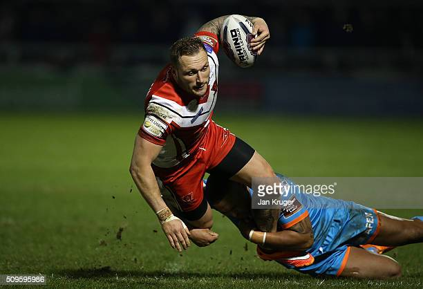 Josh Griffin of Salford Red Devils is tackled by Jordan Turner of St Helens during the First Utility Super League match between Salford City Reds and...