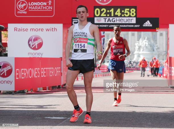 Josh Griffiths a 23yearold club runner from Cross Hands is the first British runner to cross the finish line on The Mall ranking 13th overall during...
