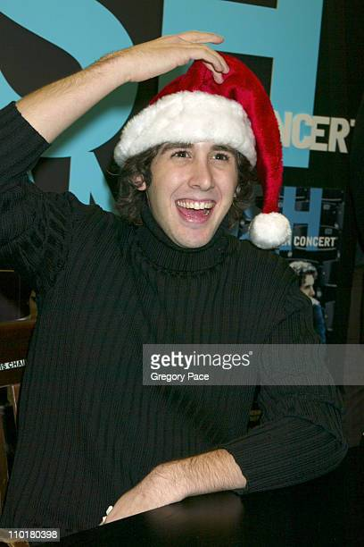 Josh Groban multiplatinum recording artist gets in the holiday spirit by donning a Santa hat given by a fan at a CD/DVD autograph appearance