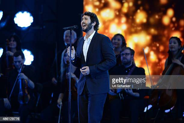 Josh Groban performs during opening night ceremonies on Arthur Ashe Stadium day 1 of the 2015 US Open at USTA Billie Jean King National Tennis Center...