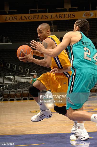 Josh Gross of the Los Angeles DFenders drives to the hoop against Luke Whitehead of the Sioux Falls Skyforce on December 4 2006 at Staples Center in...