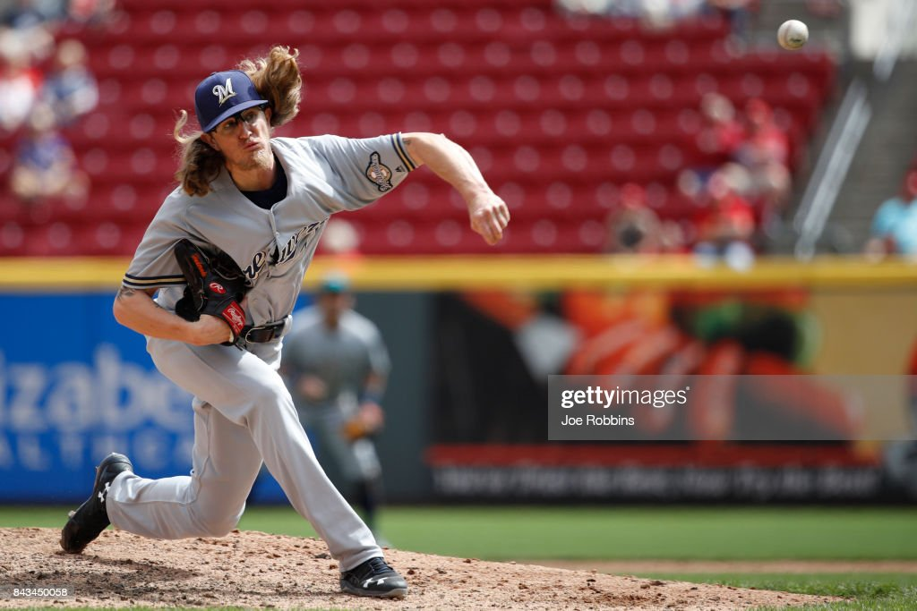 Josh Hader #71 of the Milwaukee Brewers pitches in the seventh inning of a game against the Cincinnati Reds at Great American Ball Park on September 6, 2017 in Cincinnati, Ohio. The Reds defeated the Brewers 7-1.