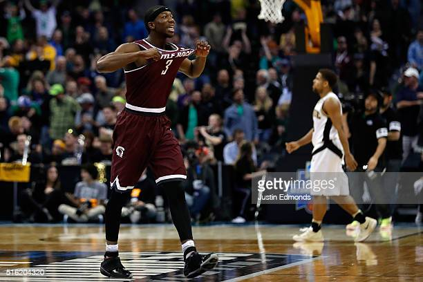 Josh Hagins of the Arkansas Little Rock Trojans reacts after the game against the Purdue Boilermakers goes into overtime during the first round of...