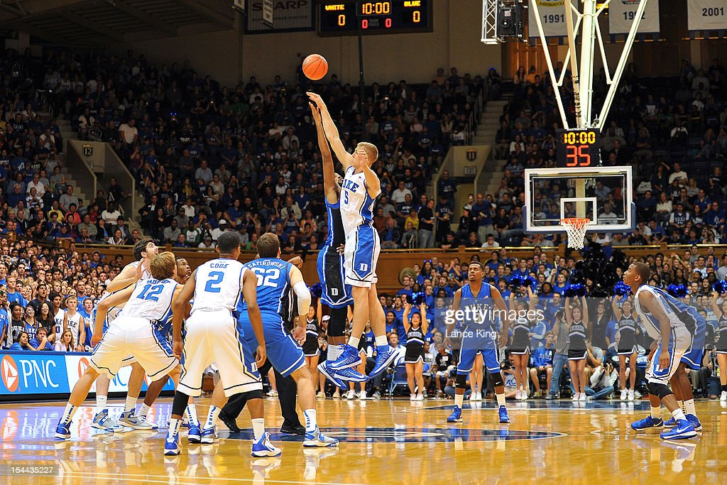 Josh Hairston #15 and <a gi-track='captionPersonalityLinkClicked' href=/galleries/search?phrase=Mason+Plumlee&family=editorial&specificpeople=5792012 ng-click='$event.stopPropagation()'>Mason Plumlee</a> #5 of the Duke Blue Devils jump for the opening tip during Countdown to Craziness at Cameron Indoor Stadium on October 19, 2012 in Durham, North Carolina.