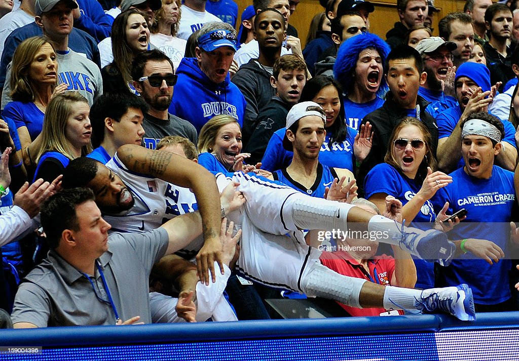 Josh Hairston #15 of the Duke Blue Devils dives into the stands to save a loose ball against the Wake Forest Demon Deacons during play at Cameron Indoor Stadium on January 5, 2013 in Durham, North Carolina.