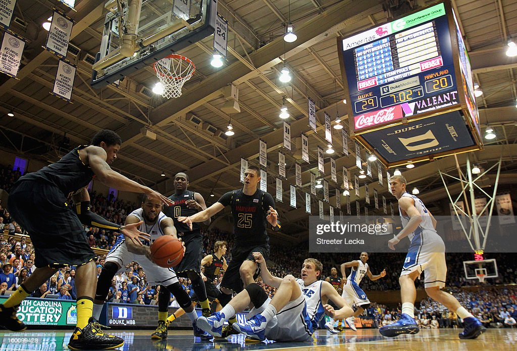 Josh Hairston #15 of the Duke Blue Devils goes after a loose ball with Nick Faust #5 of the Maryland Terrapins during their game at Cameron Indoor Stadium on January 26, 2013 in Durham, North Carolina.