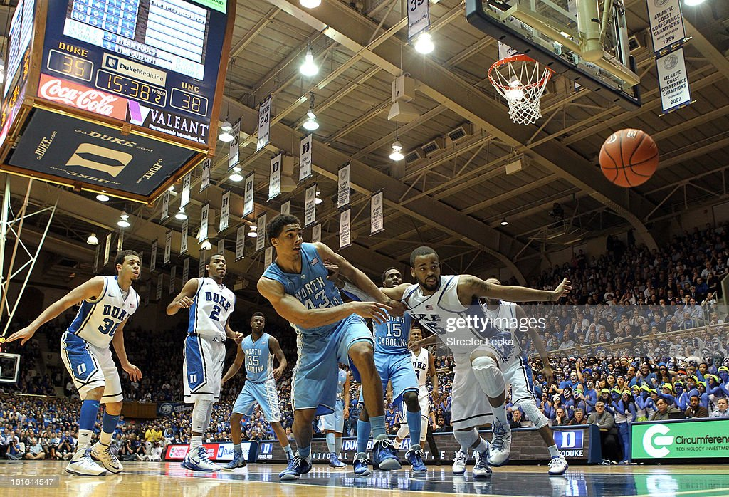 Josh Hairston #15 of the Duke Blue Devils goes after a loose ball with James Michael McAdoo #43 of the North Carolina Tar Heels during their game at Cameron Indoor Stadium on February 13, 2013 in Durham, North Carolina.