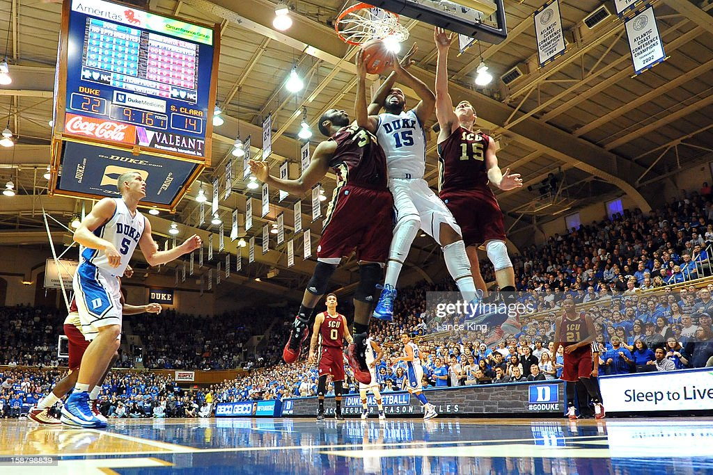 Josh Hairston #15 of the Duke Blue Devils goes to the hoop against <a gi-track='captionPersonalityLinkClicked' href=/galleries/search?phrase=Robert+Garrett&family=editorial&specificpeople=643062 ng-click='$event.stopPropagation()'>Robert Garrett</a> #35 and Marc Trasolini #15 of the Santa Clara Broncos at Cameron Indoor Stadium on December 29, 2012 in Durham, North Carolina.