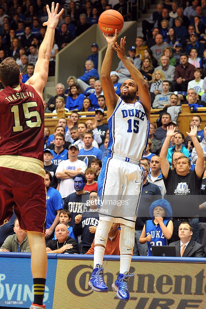 Josh Hairston #15 of the Duke Blue Devils puts up a shot against Marc Trasolini #15 of the Santa Clara Broncos at Cameron Indoor Stadium on December 29, 2012 in Durham, North Carolina.