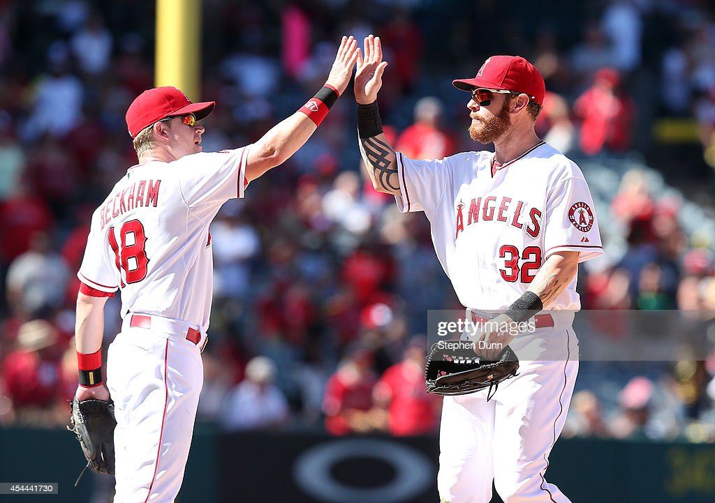 Josh Hamilton #32 and <a gi-track='captionPersonalityLinkClicked' href=/galleries/search?phrase=Gordon+Beckham&family=editorial&specificpeople=5411079 ng-click='$event.stopPropagation()'>Gordon Beckham</a> #18 of the Los Angeles Angels of Anaheim celebrate after the game with the Oakland Athletics at Angel Stadium of Anaheim on August 31, 2014 in Anaheim, California. The Angels won 8-1 to complete a four game sweep.