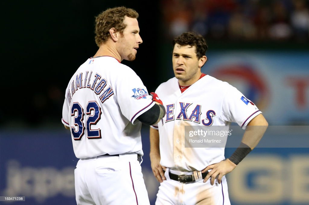 Josh Hamilton #32 and Ian Kinsler #5 of the Texas Rangers look on after Hamilton struck out to end the bottom of the eighth inning against the Baltimore Orioles during the American League Wild Card playoff game at Rangers Ballpark in Arlington on October 5, 2012 in Arlington, Texas.