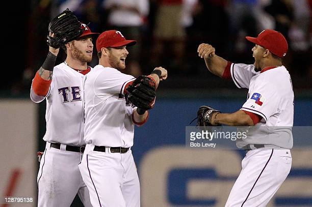 Josh Hamilton Craig Gentry and Nelson Cruz of the Texas Rangers celebrates their 32 win over the Detroit Tigers in Game One of the American League...