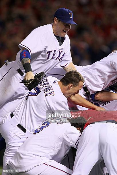 Josh Hamilton David Murphy and Andres Blanco of the Texas Rangers celebrate after defeating the New York Yankees 61 in Game Six of the ALCS to...