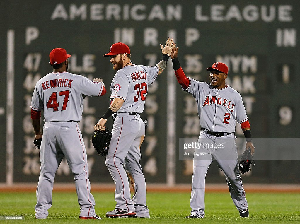 Josh Hamilton #32, <a gi-track='captionPersonalityLinkClicked' href=/galleries/search?phrase=Howie+Kendrick&family=editorial&specificpeople=628938 ng-click='$event.stopPropagation()'>Howie Kendrick</a> #47, and <a gi-track='captionPersonalityLinkClicked' href=/galleries/search?phrase=Erick+Aybar&family=editorial&specificpeople=551376 ng-click='$event.stopPropagation()'>Erick Aybar</a> #2 of the Los Angeles Angels of Anaheim celebrate a 4-3 win against the Boston Red Sox at Fenway Park on August 19, 2014 in Boston, Massachusetts.