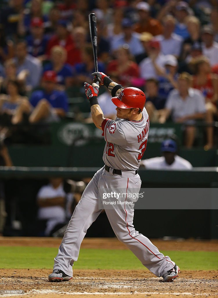 Josh Hamilton #32 of the Los Angeles Angels hits a solo homerun against the Texas Rangers at Rangers Ballpark in Arlington on July 31, 2013 in Arlington, Texas.