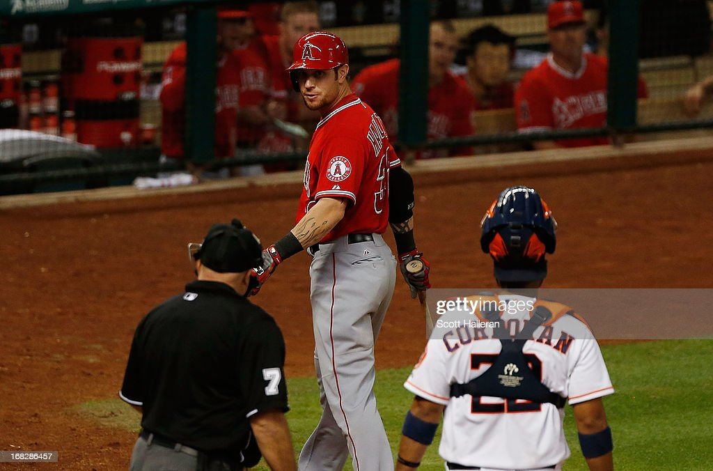 Josh Hamilton #32 of the Los Angeles Angels of Anaheim argues a called third strike with umpire Brian O'Nora during the game against the Houston Astros in the eighth inning at Minute Maid Park on May 7, 2013 in Houston, Texas.