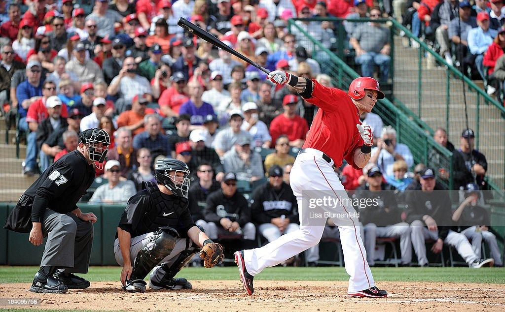 Josh Hamilton #32 of the Los Angeles Angels of Anaheim bats against the Colorado Rockies at Tempe Diablo Stadium on March 9, 2013 in Peoria, Arizona.