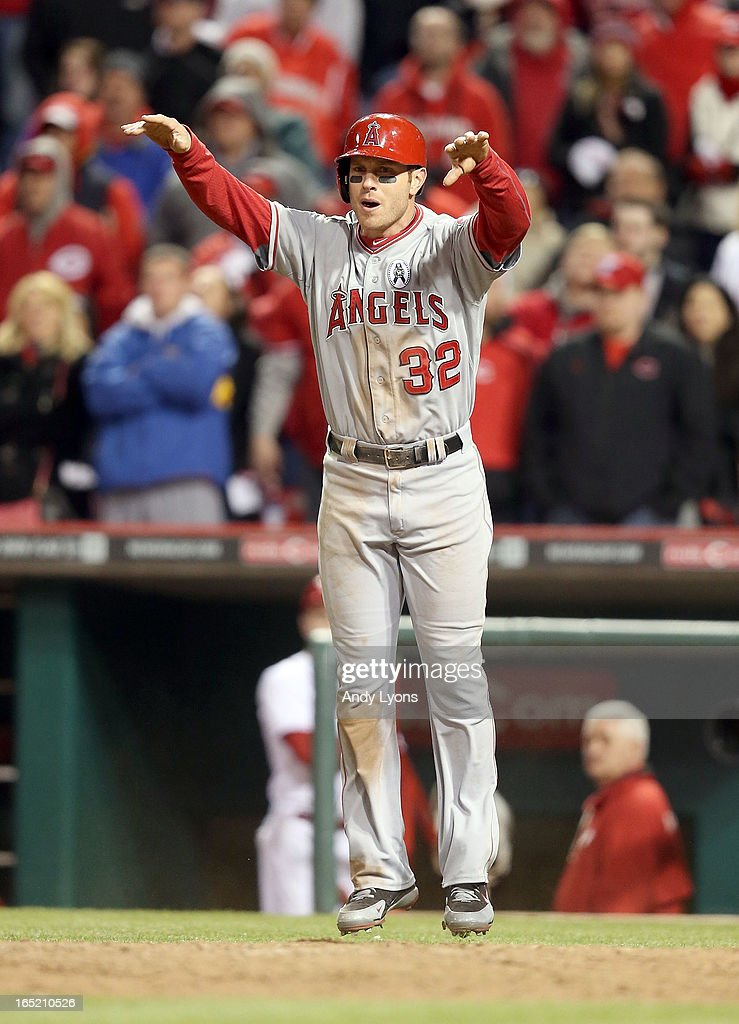 Josh Hamilton #32 of the Los Angeles Angels of Anaheim celebrates after scoring in the top of the 13th inning of the game against the Cincinnati Reds at Great American Ball Park on April 1, 2013 in Cincinnati, Ohio.