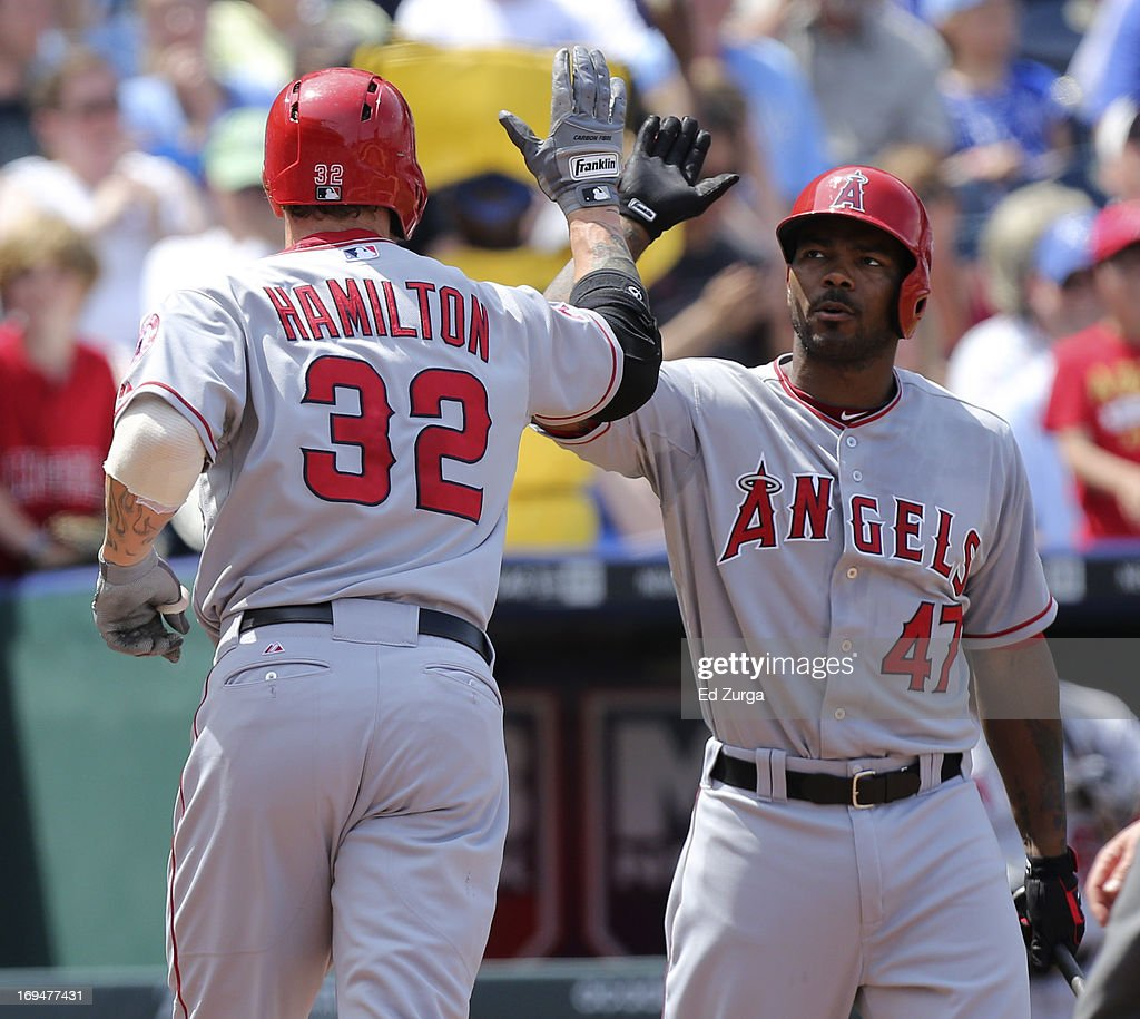 Josh Hamilton #32 of the Los Angeles Angels of Anaheim celebrates his home run with Howie Kendrick #47 in the seventh inning during a game against the Kansas City Royals at Kauffman Stadium on May 25, 2013 in Kansas City, Missouri.