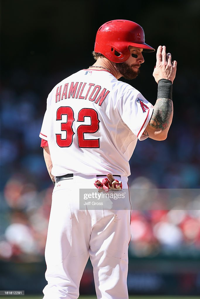 Josh Hamilton #32 of the Los Angeles Angels of Anaheim gestures towards first base umpire James Hoye (not pictured) in the eighth inning against the Oakland Athletics at Angel Stadium of Anaheim on September 25, 2013 in Anaheim, California. The Angels defeated the Athletics 3-1.