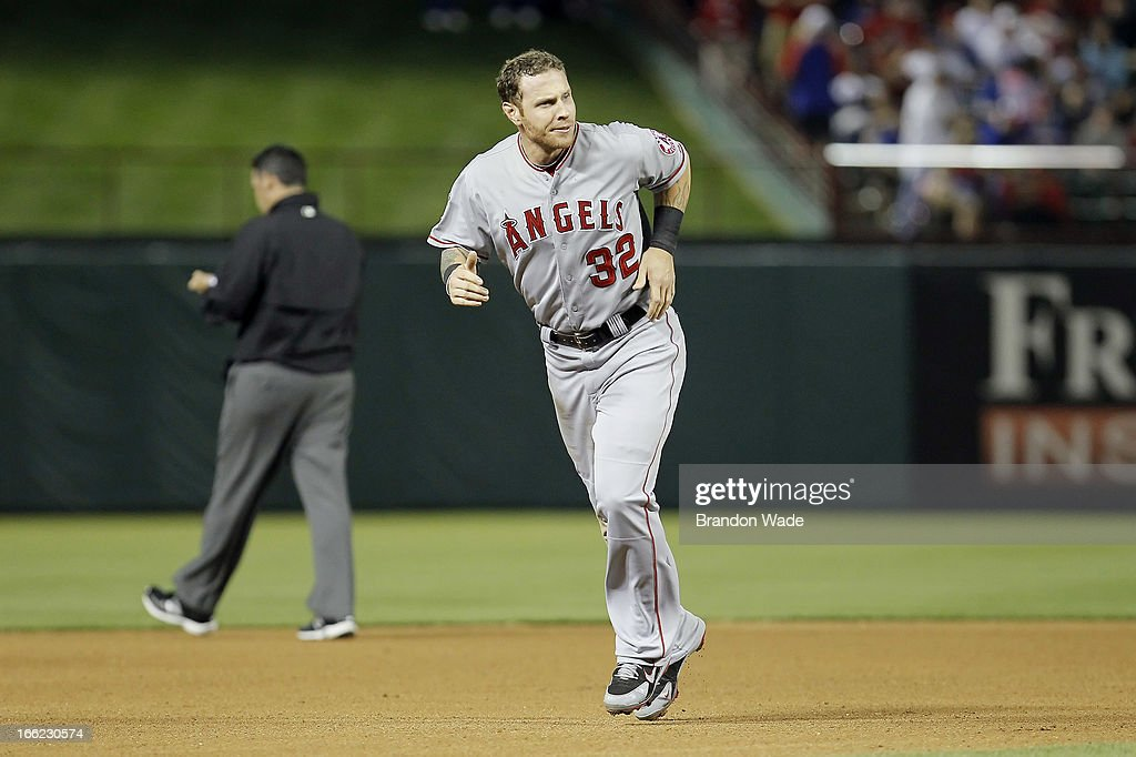 Josh Hamilton #32 of the Los Angeles Angels of Anaheim heads toward the dugout to retrieve his hat and glove in the seventh inning of a baseball game against the Texas Rangers at Rangers Ballpark in Arlington on April 7, 2013 in Arlington, Texas. Texas won 7-3.