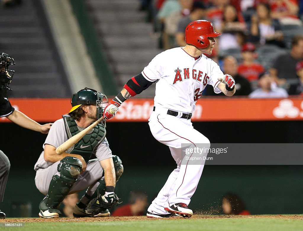 Josh Hamilton #32 of the Los Angeles Angels of Anaheim hits a double in the third inning against the Oakland Athletics at Angel Stadium of Anaheim on April 10, 2013 in Anaheim, California.
