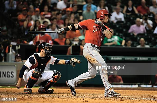 Josh Hamilton of the Los Angeles Angels of Anaheim hits a solo home run in the eighth inning of their game against the Houston Astros at Minute Maid...