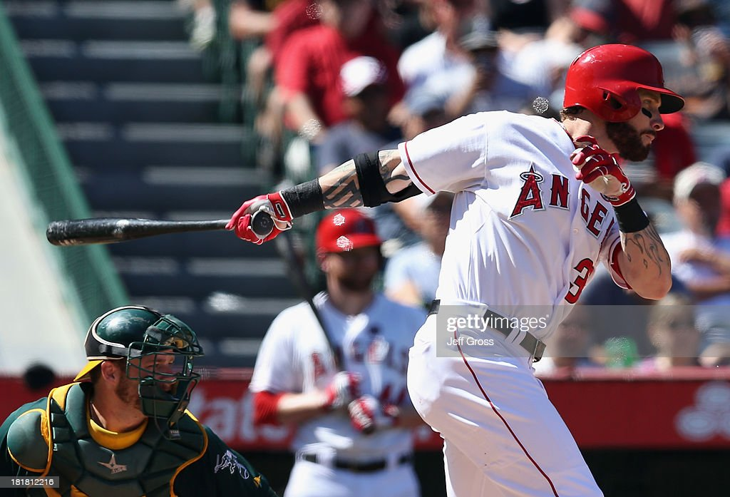 Josh Hamilton #32 of the Los Angeles Angels of Anaheim hits an RBI single in the fifth inning against the Oakland Athletics at Angel Stadium of Anaheim on September 25, 2013 in Anaheim, California. The Angels defeated the Athletics 3-1.