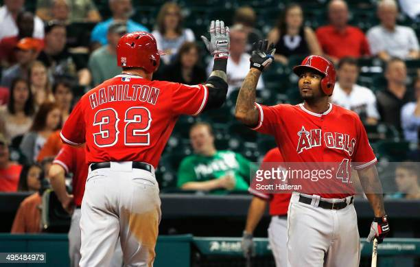Josh Hamilton of the Los Angeles Angels of Anaheim is greeted at the plate by teammate Howie Kendrick after Hamilton hit a solo home run in the...