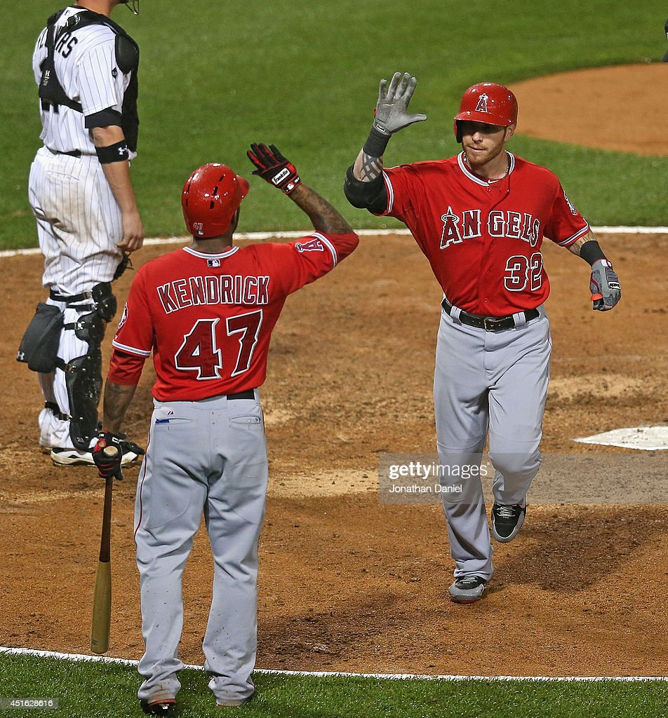 Josh Hamilton #32 of the Los Angeles Angels of Anaheim is greeted by Howie Kendrick #47 after hitting a solo home run in the 8th inning against the Chicago White Sox at U.S. Cellular Field on July 2, 2014 in Chicago, Illinois. The White Sox defeated the Angels 3-2.