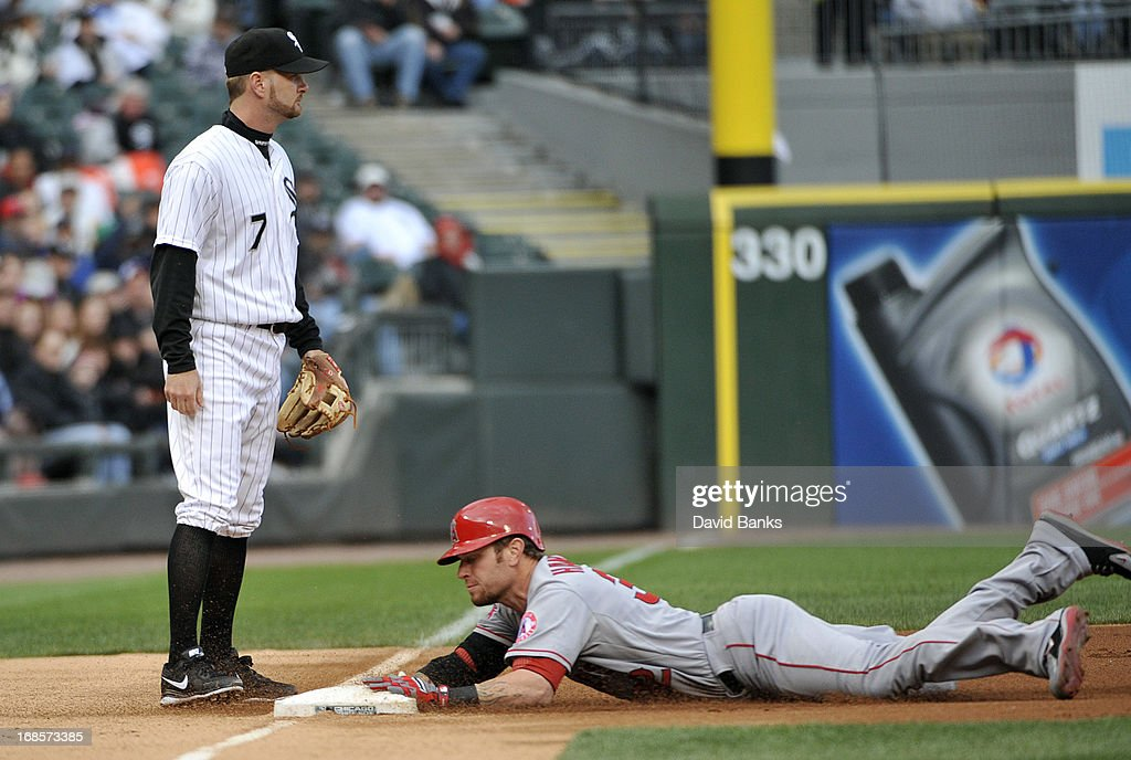 Josh Hamilton #32 of the Los Angeles Angels of Anaheim is safe at third base as Jeff Keppinger #7 of the Chicago White Sox waits for a throw during the first inning on May 11, 2013 at U.S. Cellular Field in Chicago, Illinois.