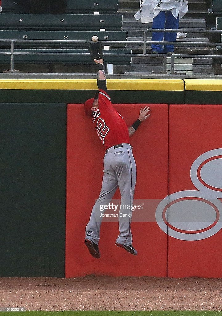 Josh Hamilton #32 of the Los Angeles Angels of Anaheim leaps to make a catch at the wall on a ball hit by Gordon Beckham of the Chicago White Sox in the 1st inning at U.S. Cellular Field on July 2, 2014 in Chicago, Illinois.