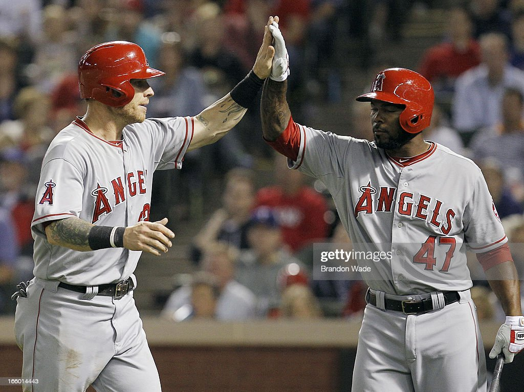 Josh Hamilton #32 of the Los Angeles Angels of Anaheim, left, is congratulated by team Howard Kendrick #47 after scoring a run in the fifth inning of a baseball game against the Texas Rangers at Rangers Ballpark in Arlington on April 7, 2013 in Arlington, Texas. Texas won 7-3.