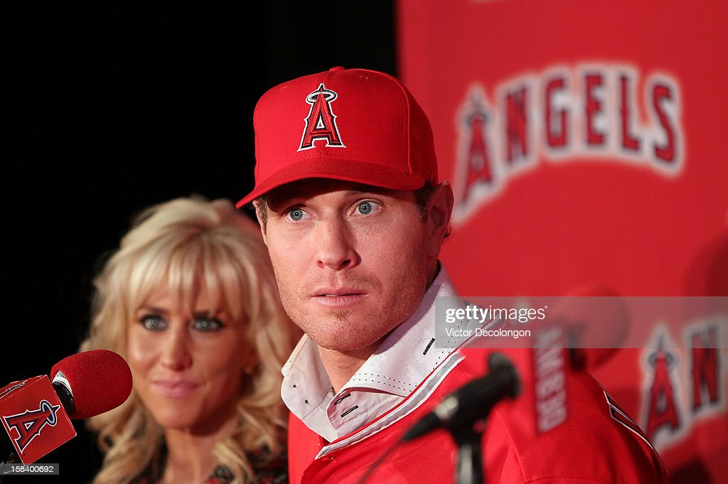 Josh Hamilton #32 of the Los Angeles Angels of Anaheim listens to a question from the media as wife Katie looks on during the press conference introducing Hamilton as the team's newest member at ESPN Zone at Downtown Disney on December 15, 2012 in Anaheim, California.