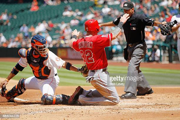Josh Hamilton of the Los Angeles Angels of Anaheim scores in the first inning as Carlos Corporan of the Houston Astros is late on the tag at Minute...