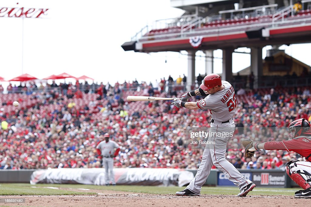 Josh Hamilton #32 of the Los Angeles Angels of Anaheim singles to drive in two runs in the third inning against the Cincinnati Reds during the game at Great American Ball Park on April 4, 2013 in Cincinnati, Ohio.