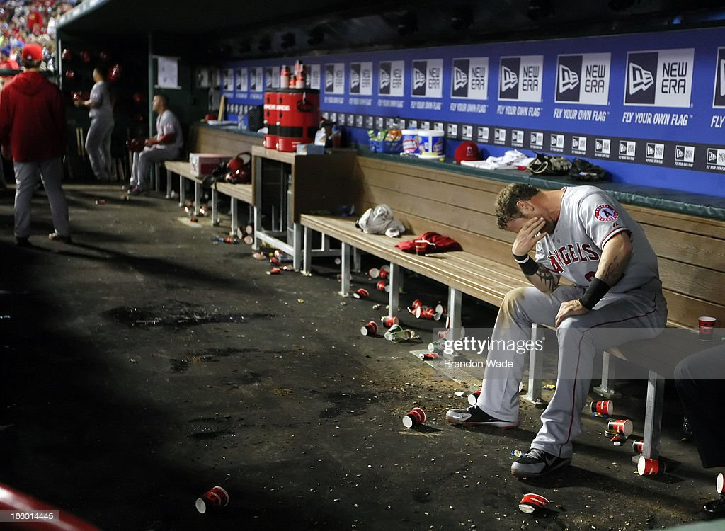 Josh Hamilton #32 of the Los Angeles Angels of Anaheim sits in the dugout after scoring a run in the sixth inning of a baseball game against the Texas Rangers at Rangers Ballpark in Arlington on April 7, 2013 in Arlington, Texas.
