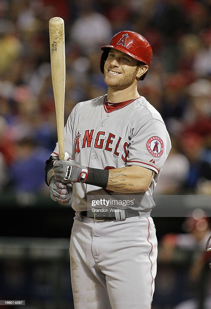 Josh Hamilton #32 of the Los Angeles Angels of Anaheim smiles as the crowd chants 'Baseball Town' during the ninth inning of a baseball game against the Texas Rangers at Rangers Ballpark in Arlington on April 7, 2013 in Arlington, Texas.
