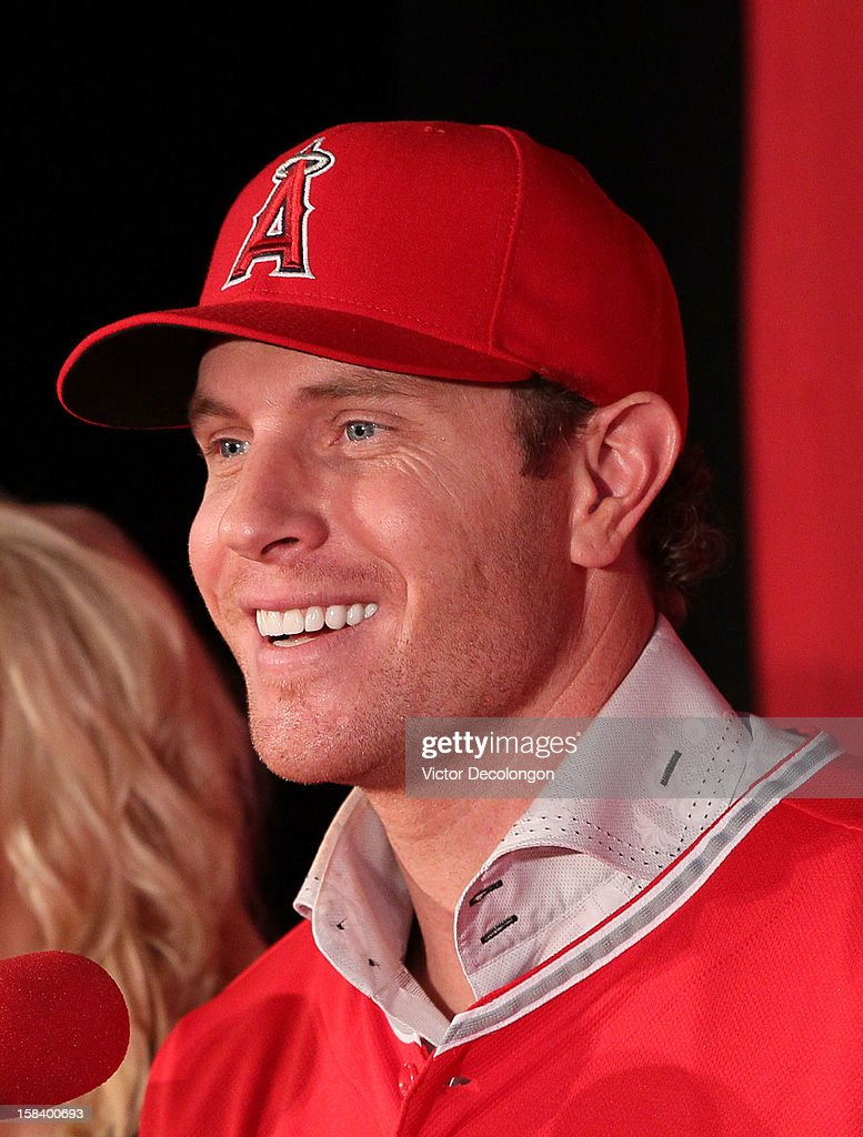 Josh Hamilton #32 of the Los Angeles Angels of Anaheim smiles during the press conference introducing Hamilton as the team's newest member at ESPN Zone at Downtown Disney on December 15, 2012 in Anaheim, California.