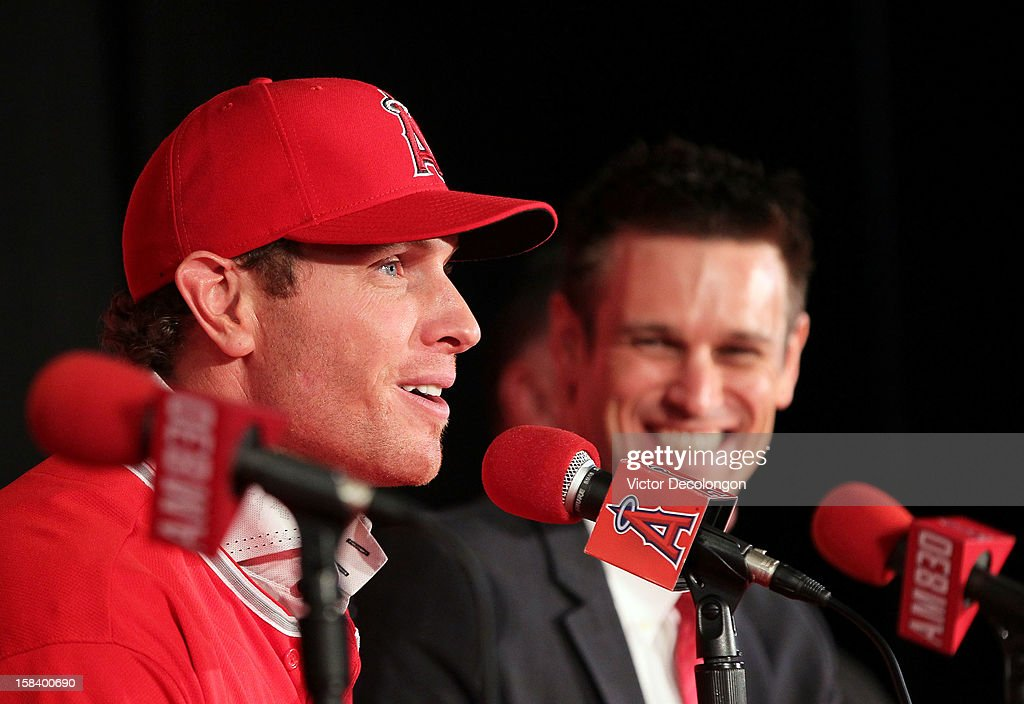 Josh Hamilton #32 of the Los Angeles Angels of Anaheim speaks during the press conference introducing Hamilton as the team's newest player as Angels General Manager Jerry Dipoto laughs at ESPN Zone at Downtown Disney on December 15, 2012 in Anaheim, California.
