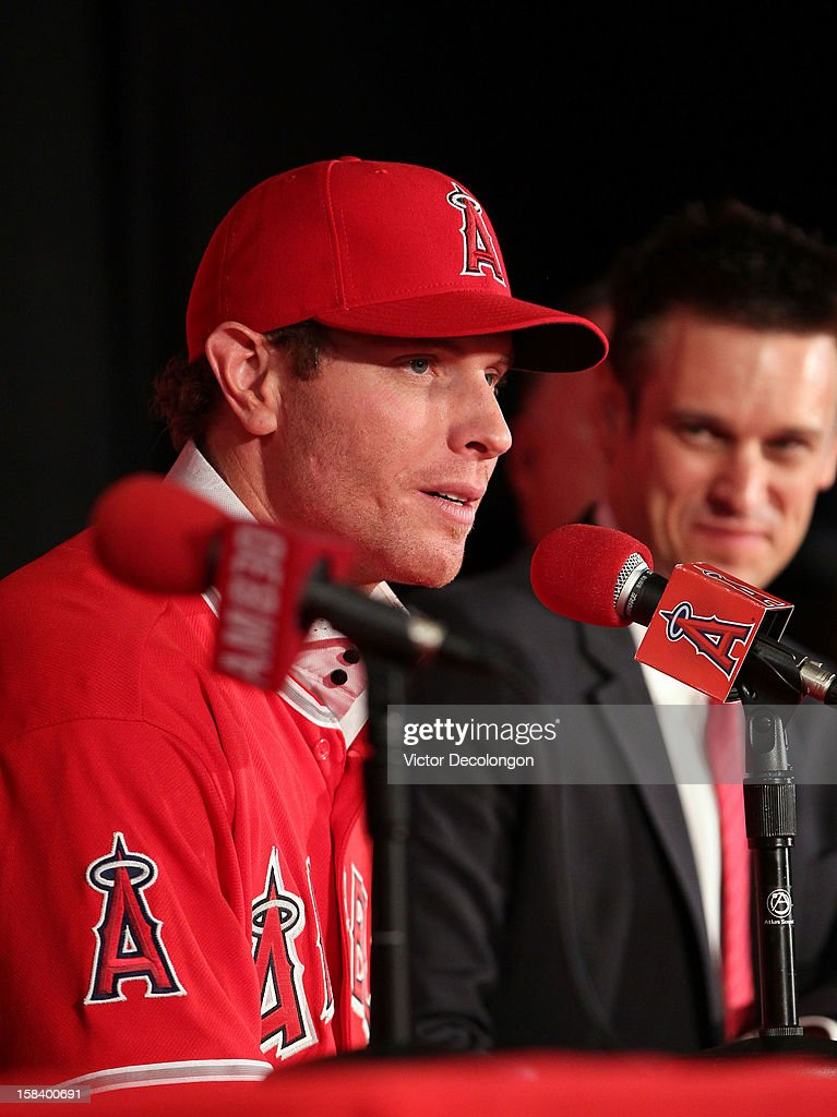 Josh Hamilton #32 of the Los Angeles Angels of Anaheim speaks during the press conference introducing Hamilton as the team's newest player as Angels General Manager Jerry Dipoto looks on at ESPN Zone at Downtown Disney on December 15, 2012 in Anaheim, California.
