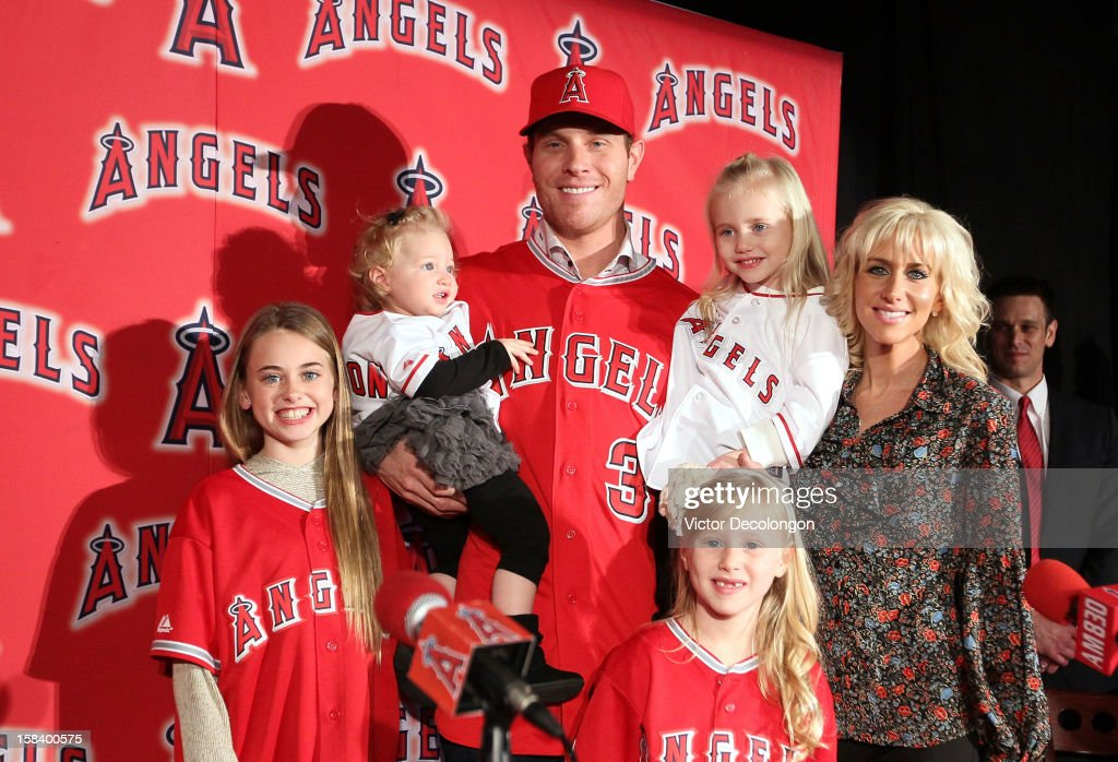Josh Hamilton #32 of the Los Angeles Angels of Anaheim (C) stands with his family, (L-R), Julia, Stella (on right arm), Sierra, Michaela Grace (on left arm) and wife Katie for a group photo during the press conference to introduce Josh Hamilton at ESPN Zone at Downtown Disney on December 15, 2012 in Anaheim, California.